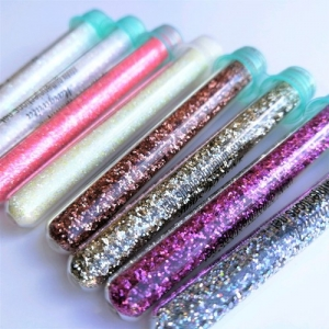GLITTER INJECTIONS IN GLASS PACKAGING